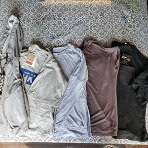 New and gently used Reebok top lot